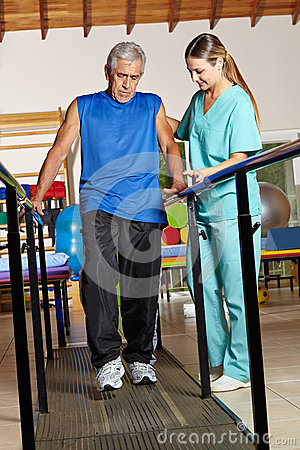 Old man at physiotherapy