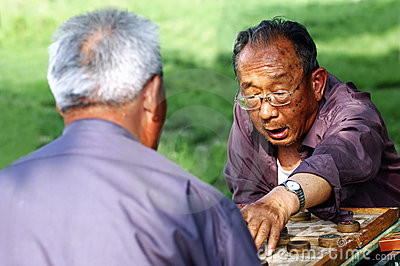 Old man play Chinese Chess