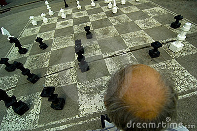 Old Man Playing Oversize Chess
