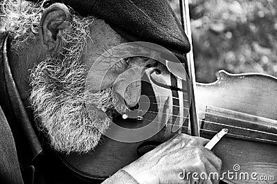 Old man playing violin