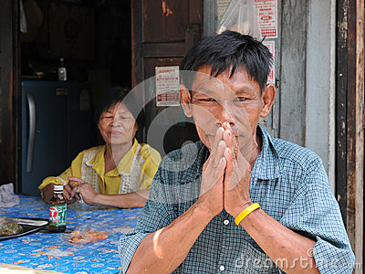 Old Man Salutes with a Traditional Thai Greeting Editorial Image