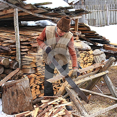 Free Old Man Sawing The Firewood Stock Photos - 69905473