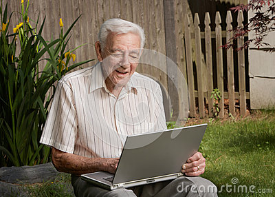 Old man senior working on computer