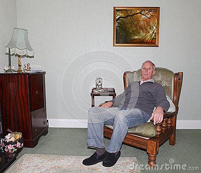 Old man sitting in his armchair