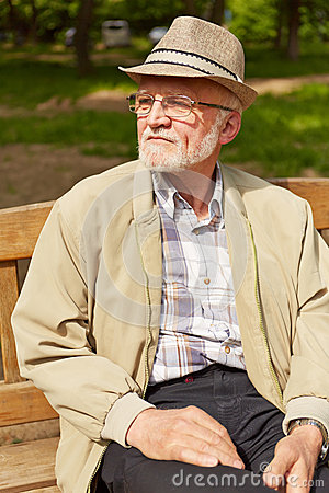 Free Old Man Sitting On Park Bench Stock Images - 46579764