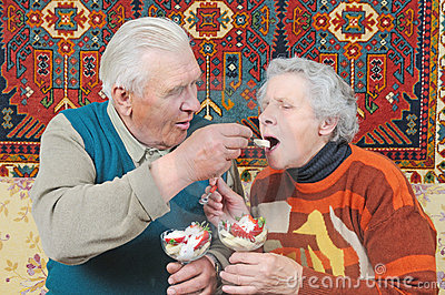 Old man spoon-feed old woman