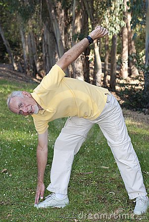 Old man touching toes to keep fit