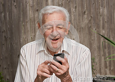 Old man using smart phone