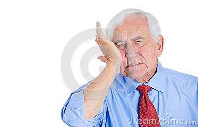 old man wearing blue shirt with tooth ache