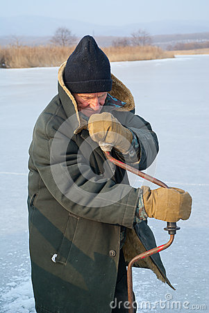 Old man on winter fishing 1