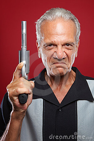 Free Old Man With A Revolver Royalty Free Stock Photography - 20994787