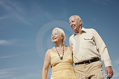 Old man and woman contemplating the sky
