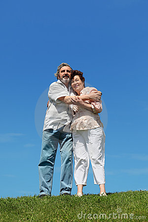 Old man and woman embracing and smiling Stock Photo