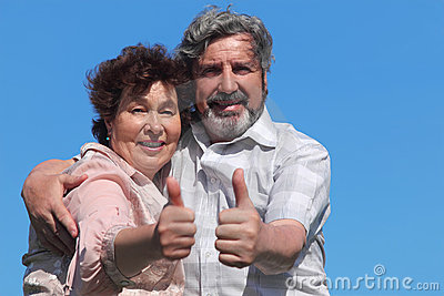 Old man and woman making thumbs up gesture Stock Photo