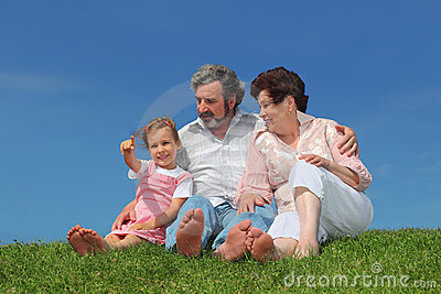 Old man and woman sitting with granddaughter