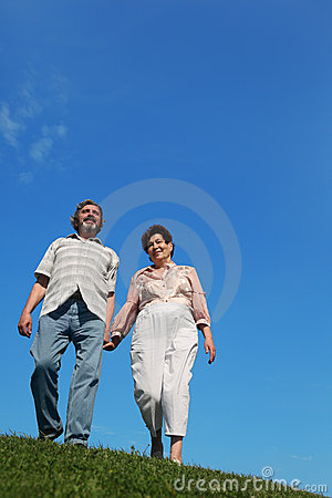 Old man and woman standing on hill