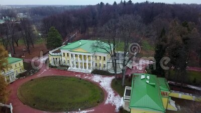 Drone. Flying over the estate in the park. Old manor in the Moscow region. Russia. The video was taken by a drone. frame house with a green roof and autumn park stock video footage