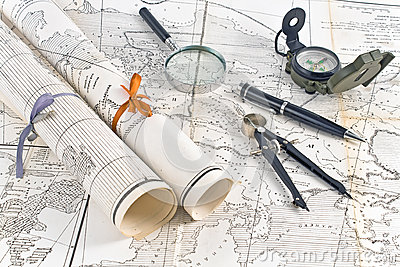Old Maps in rolls with magnifier and compass