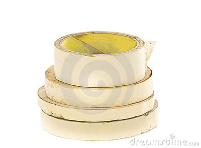Old masking tape rolls isolated on white