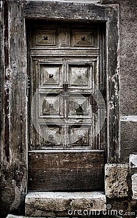 Old Medieval Wooden Door in Historic Building