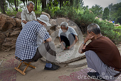 Old men playing chess Editorial Photography