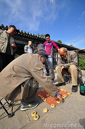 Old men playing chess in a park in Spring Editorial Photography
