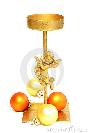 Old metal candlestick with angel and christmas balls