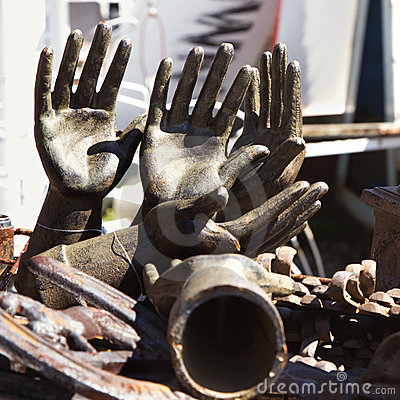 Old metal hand statuettes.
