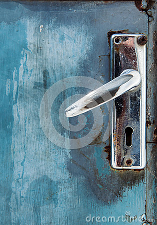 Old metal lock on blue grunge door