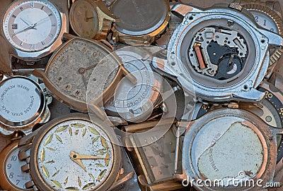 Old metal parts scrap wrist watch faces closeup