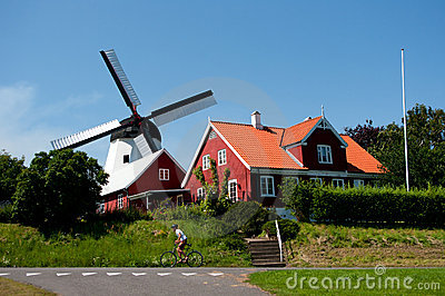 Old mill and cyclist.