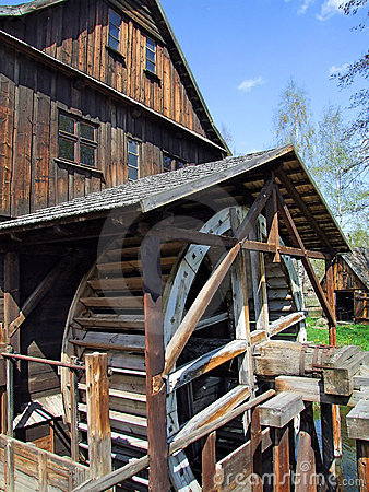An old mill with water wheel in Poland