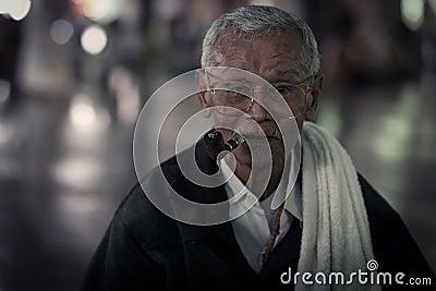 old Mon man smoke cigarette Editorial Photo