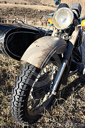 Old motocycle with buddy seat.