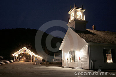 Old new england covered bridge with church at night