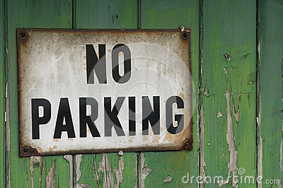Old no parking sign on garage door