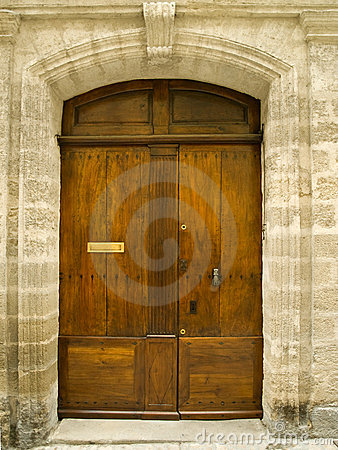 Old Oak Door In Stone Frame Royalty Free Stock Photo