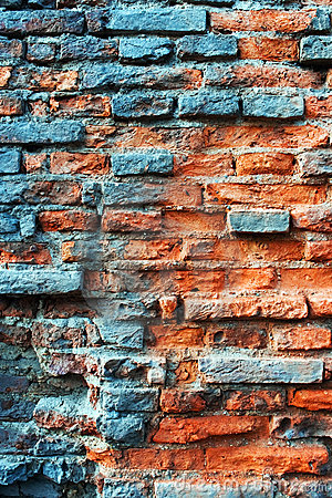 Old obsolete rusted red brick wall