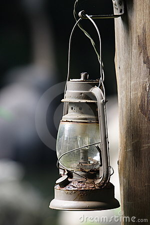 Old oil lamp with a light bulb