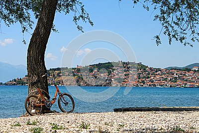 Old orange bicycle with a beautiful landscape