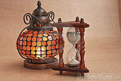 Old oriental lamp and hourglass