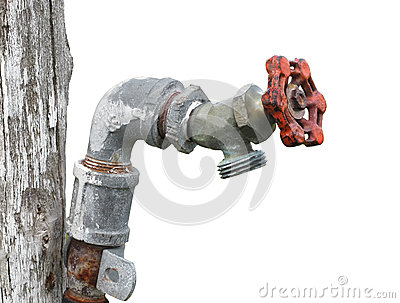 Old outside water tap isolated