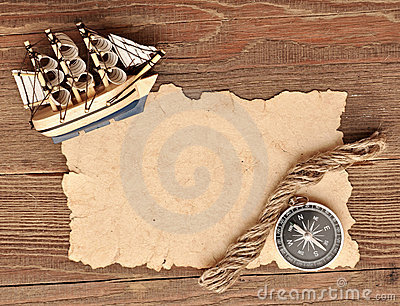 Old Paper, Compass, Rope And Model Classic Boat