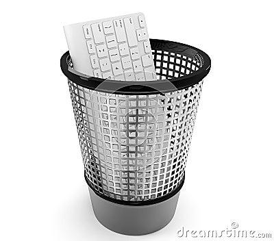Old PC keyboard in metal trash bin