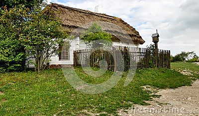 Old peasant house with thatched roof