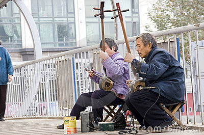 Old people play erhu for charity Editorial Photo