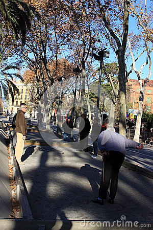 Old people playing Petanque in Barcelona Editorial Image