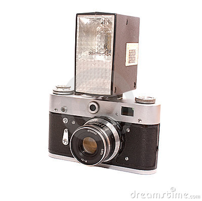 Old photo camera with flash