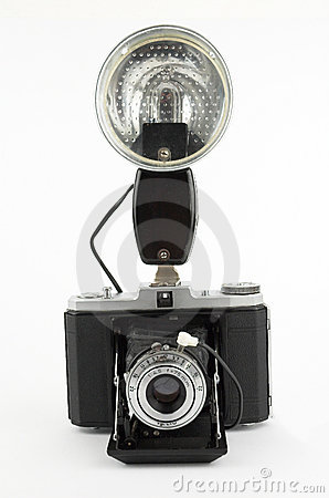 Old photo camera with strobe flash