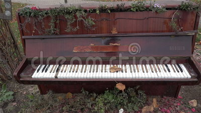 The old piano outside. Antique musical instruments. History. Museum, Art HD Stock Photo